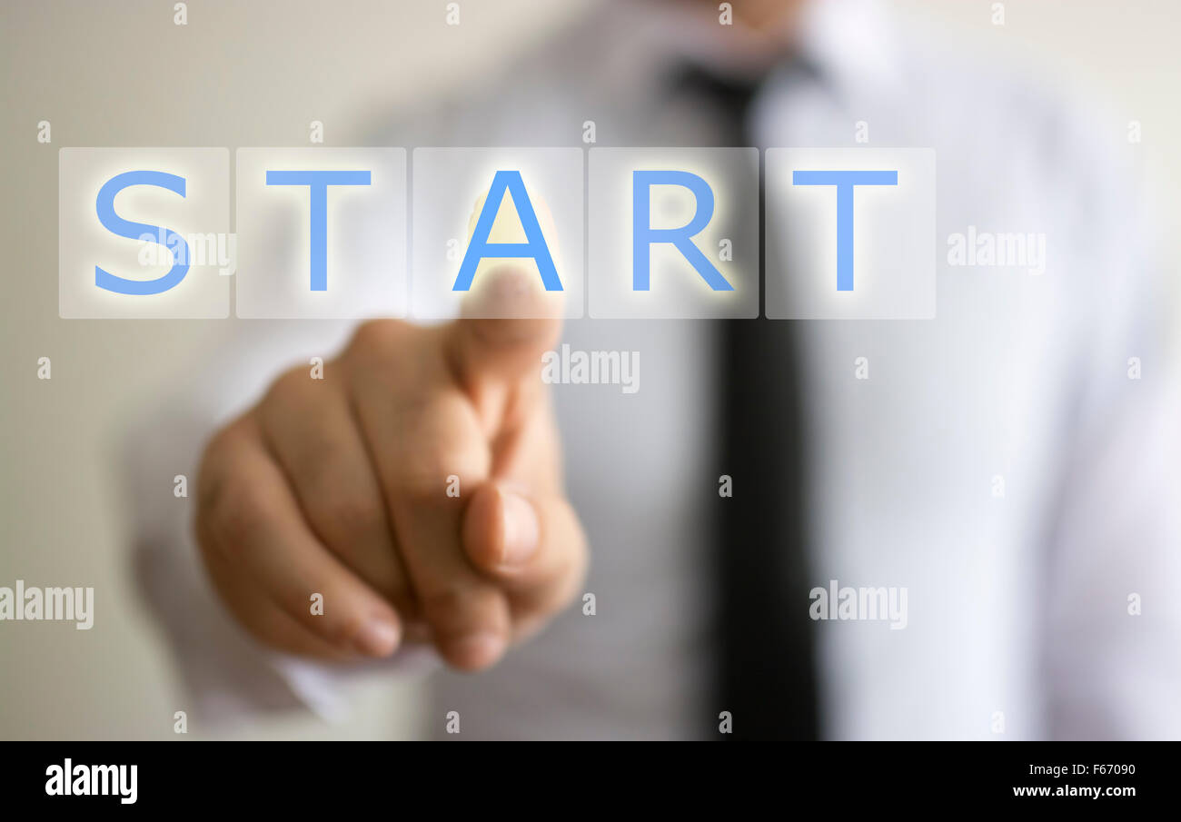 Man touching start button - Stock Image