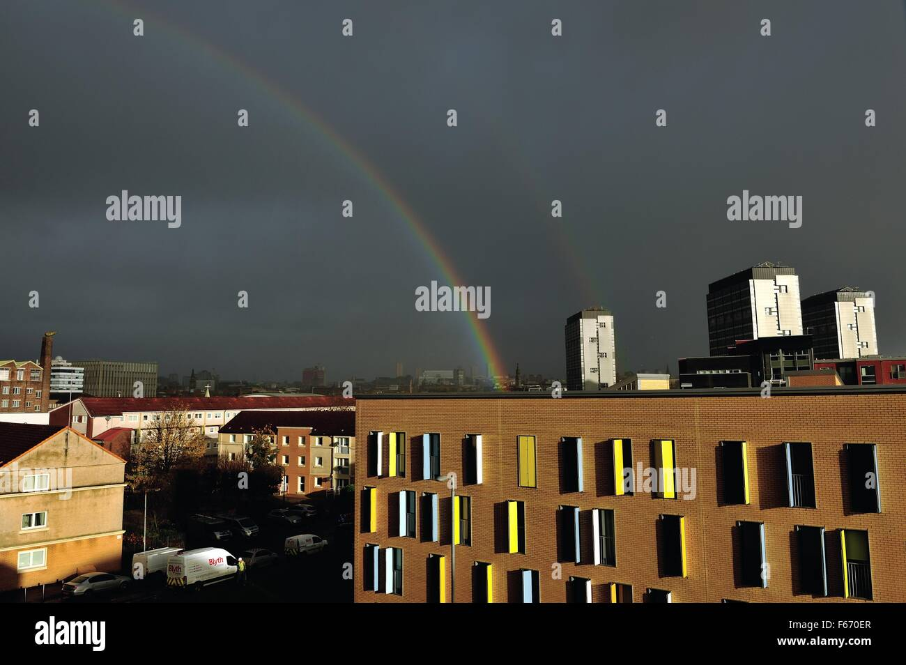 Glasgow, Scotland, UK. 13th Nov, 2015. Dark skies and a double rainbow over Glasgow after Storm Abigail passes through - Stock Image