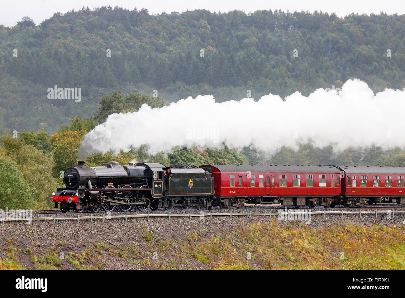 Steam locomotive LMS Jubilee Class Leander 45690 on the Settle to Carlisle Railway Line near Lazonby, Eden Valley, Stock Photo