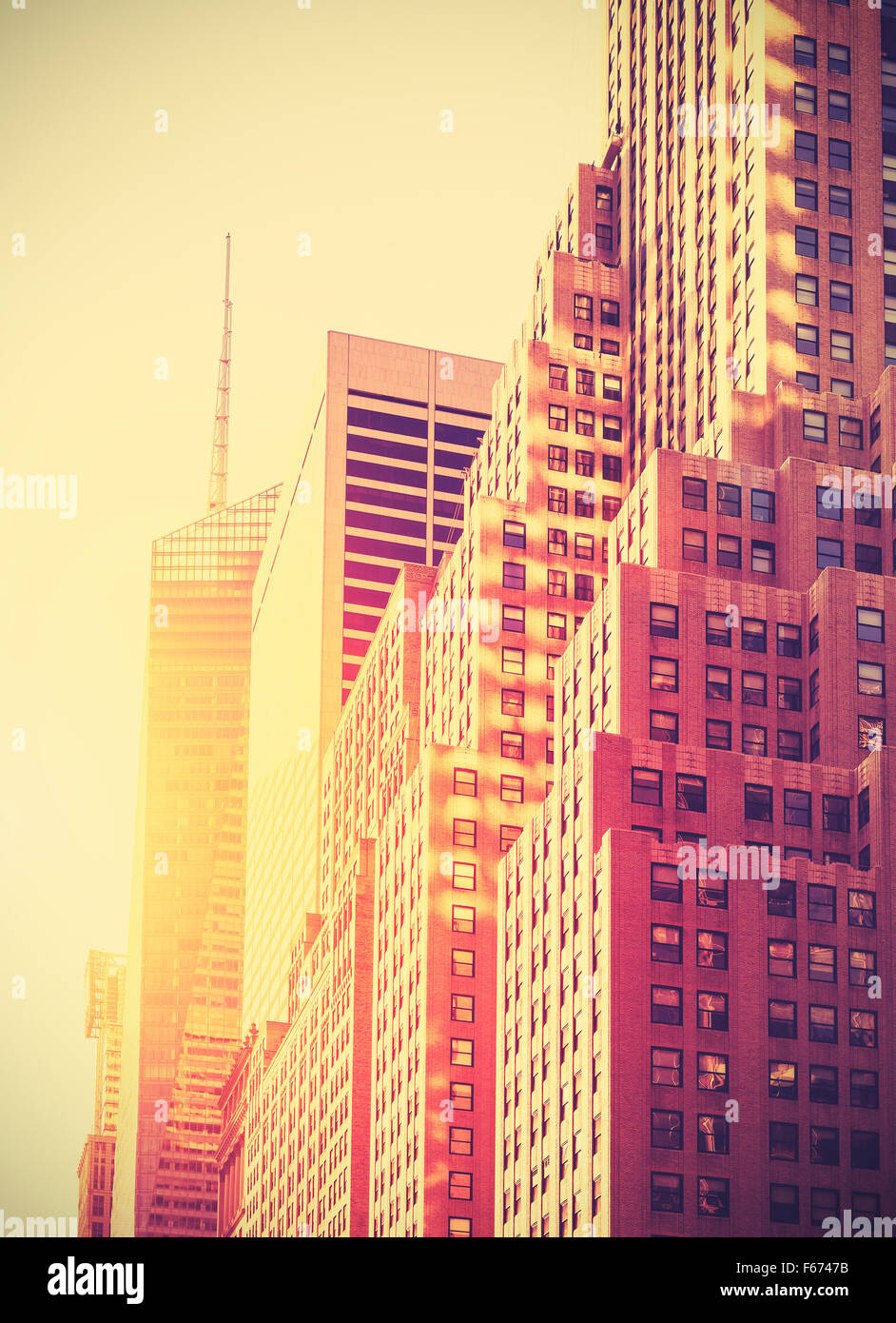 Vintage toned photo of skyscrapers in Manhattan at sunset, New York City, USA. - Stock Image