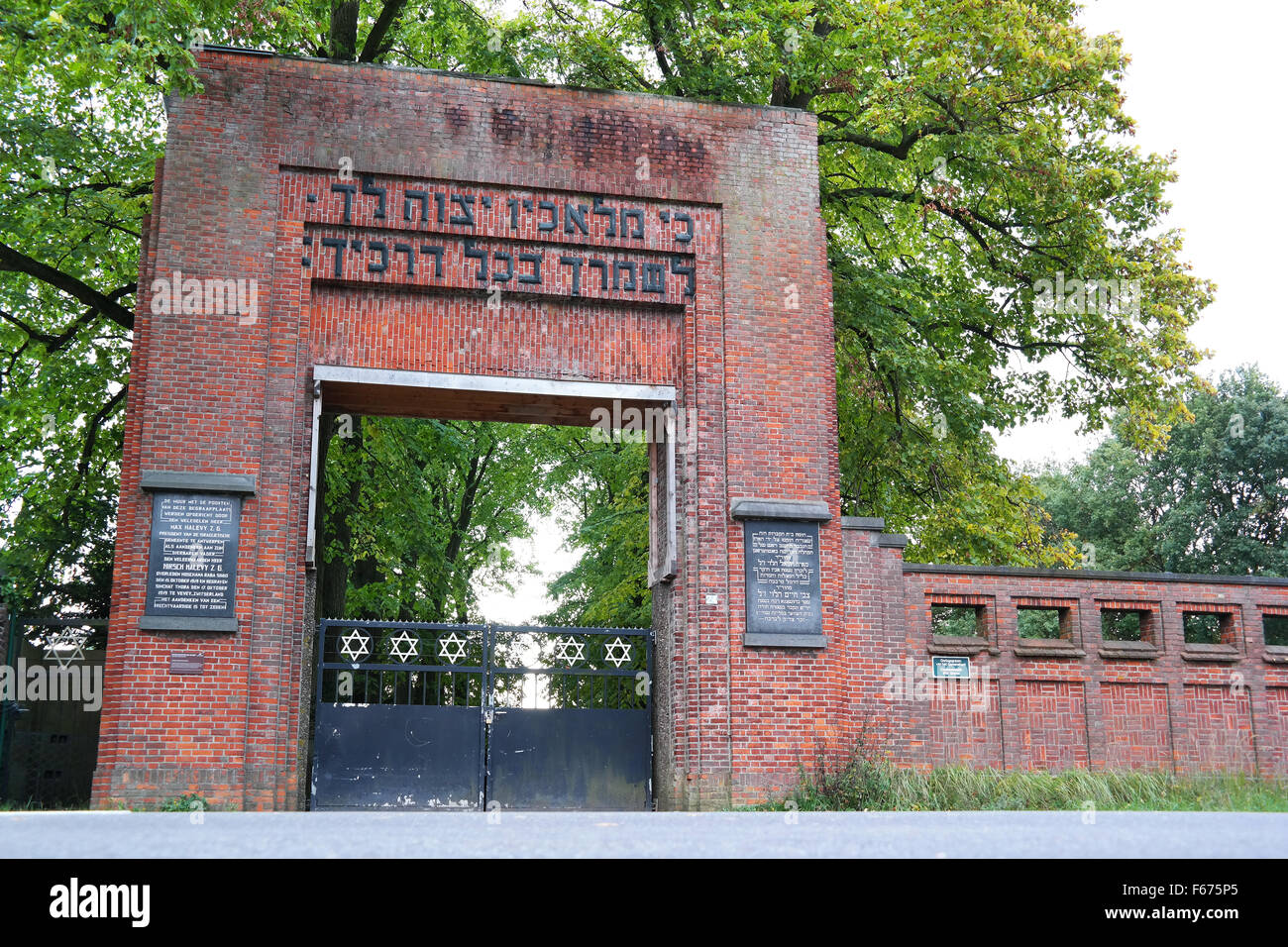 Gate of one of the three extensive Jewish cemeteries with many graves of Belgian Haredi Jews in Putte, The Netherlands - Stock Image