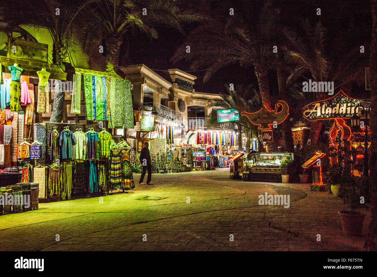 Main street of souvenir shops and restaurants at night in Dahab, Egypt. - Stock Image