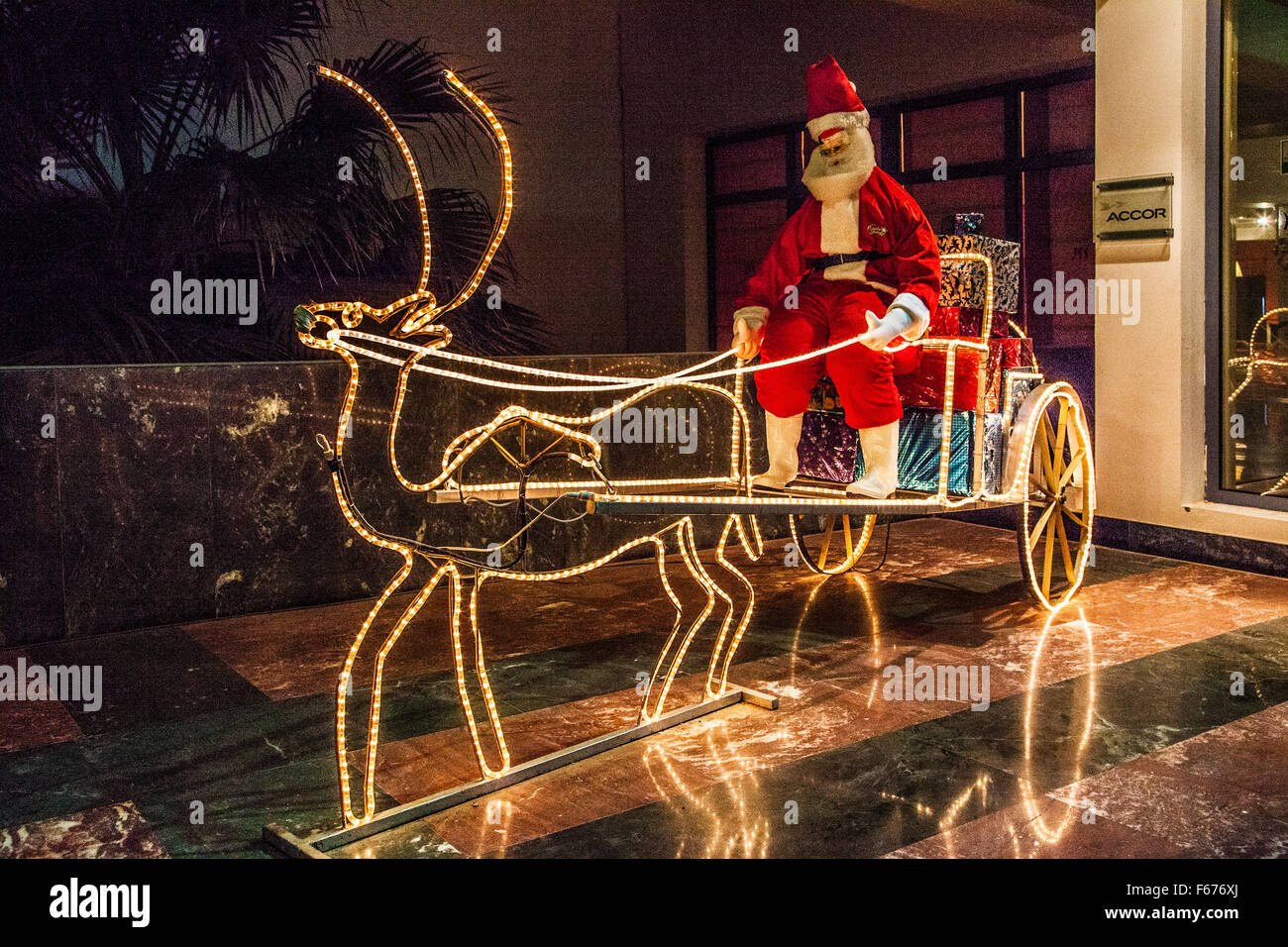 Father Christmas on his sleigh outside a hotel in Dahab, Egypt. - Stock Image