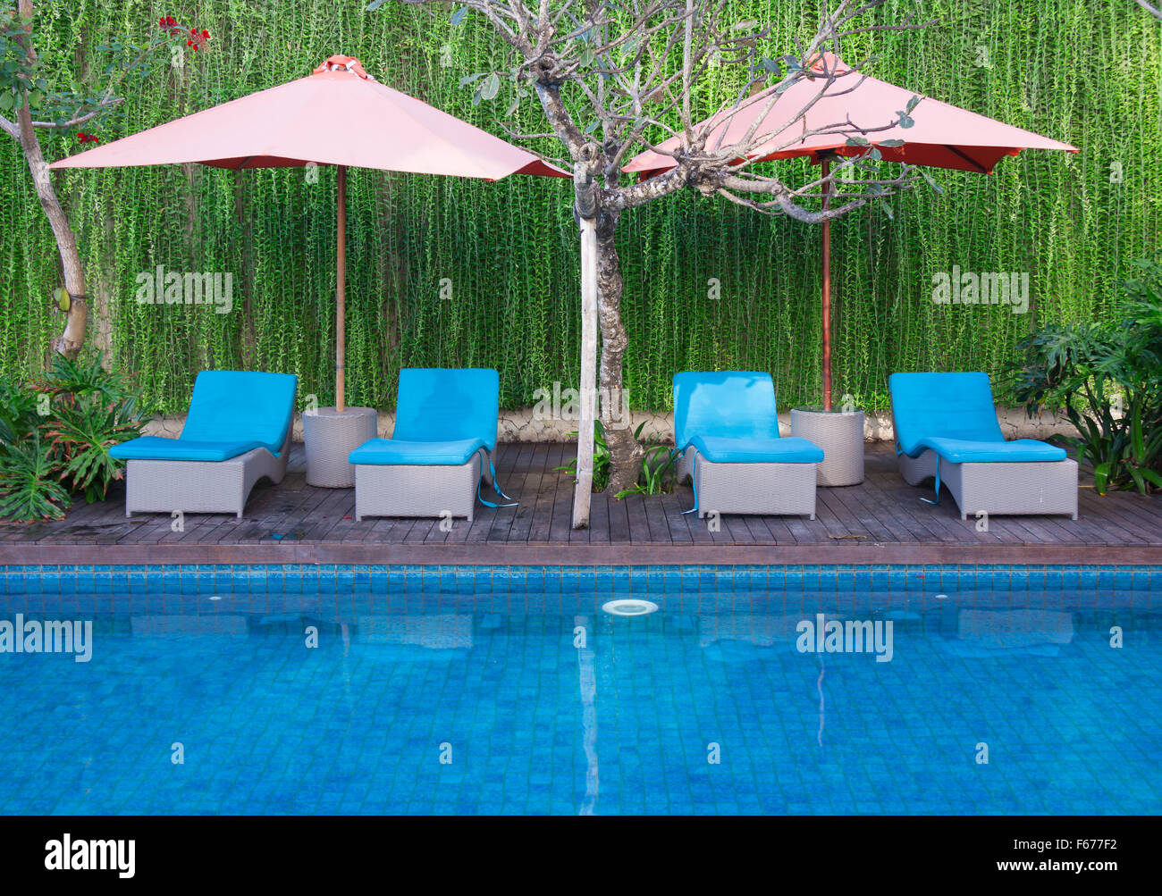 Relaxing chairs beside of swimming pool Stock Photo ...
