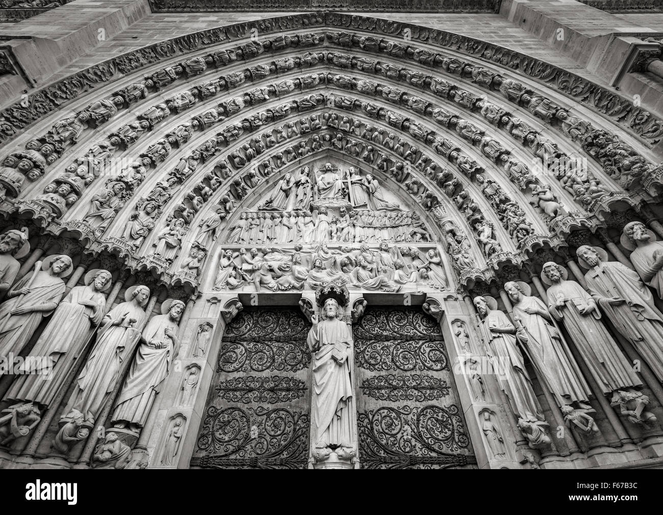 Central gothic portal of Notre Dame de Paris Cathedral featuring bas relief of the Last Judgement. Ile de la Cité, - Stock Image