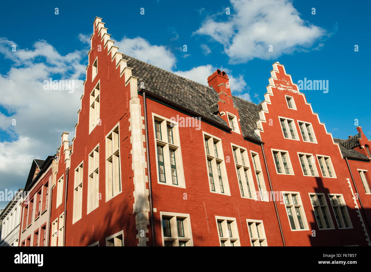 Red gable roof of a historic house in Ghent, Belgium. - Stock Image