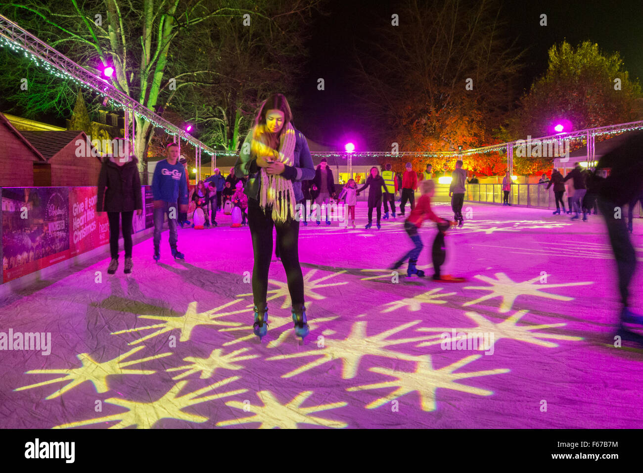 Winchester Cathedral Inner Close open-air real ice rink at night. - Stock Image