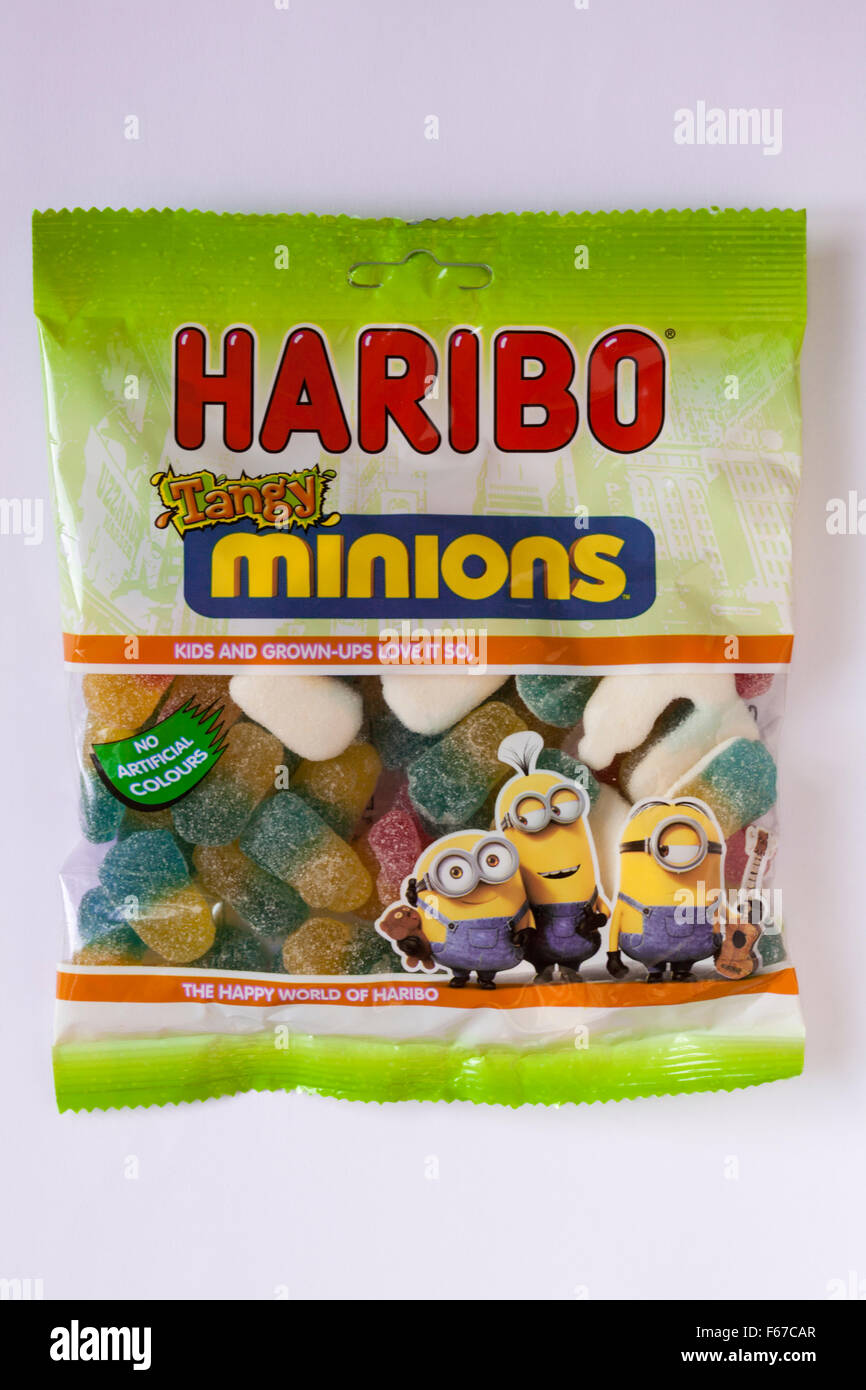 packet of Haribo Tangy Minions isolated on white background - Stock Image