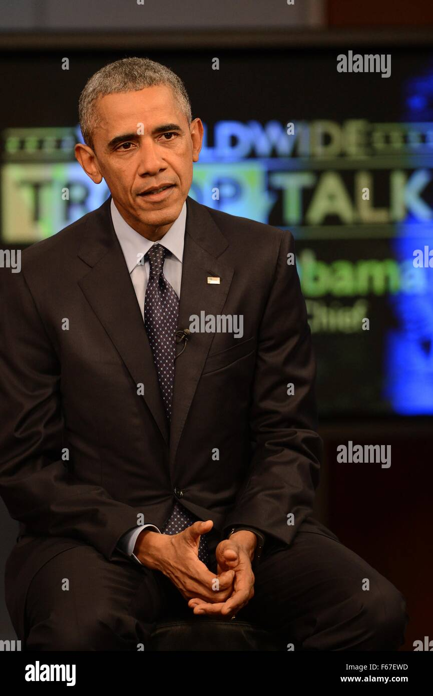 U.S. President Barack Obama answers a question during a Worldwide Troop Talk broadcast on the anniversary of the - Stock Image