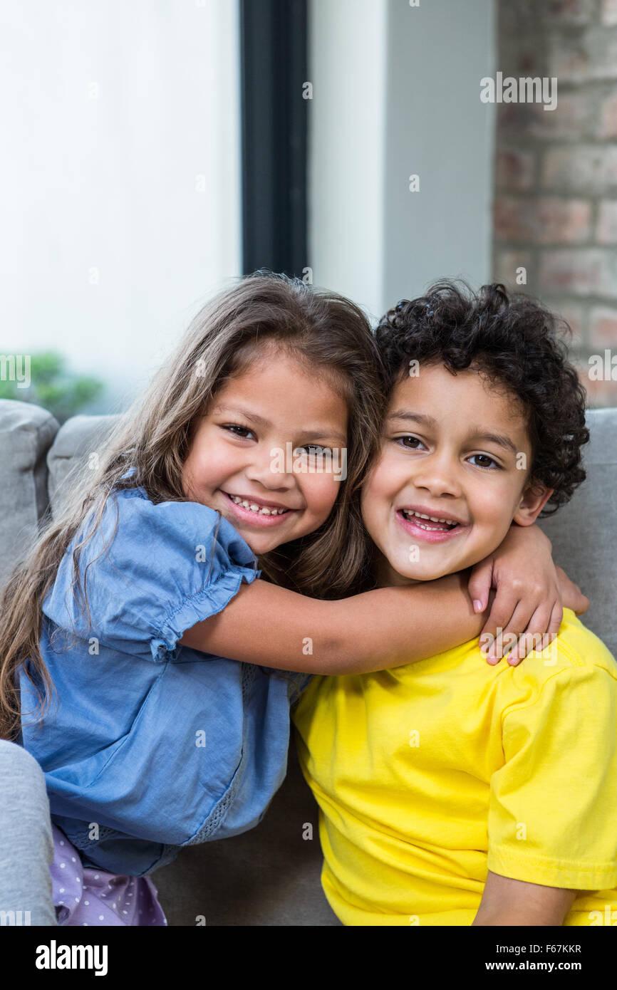 cute siblings hugging on the sofa stock photo 89908891 alamy