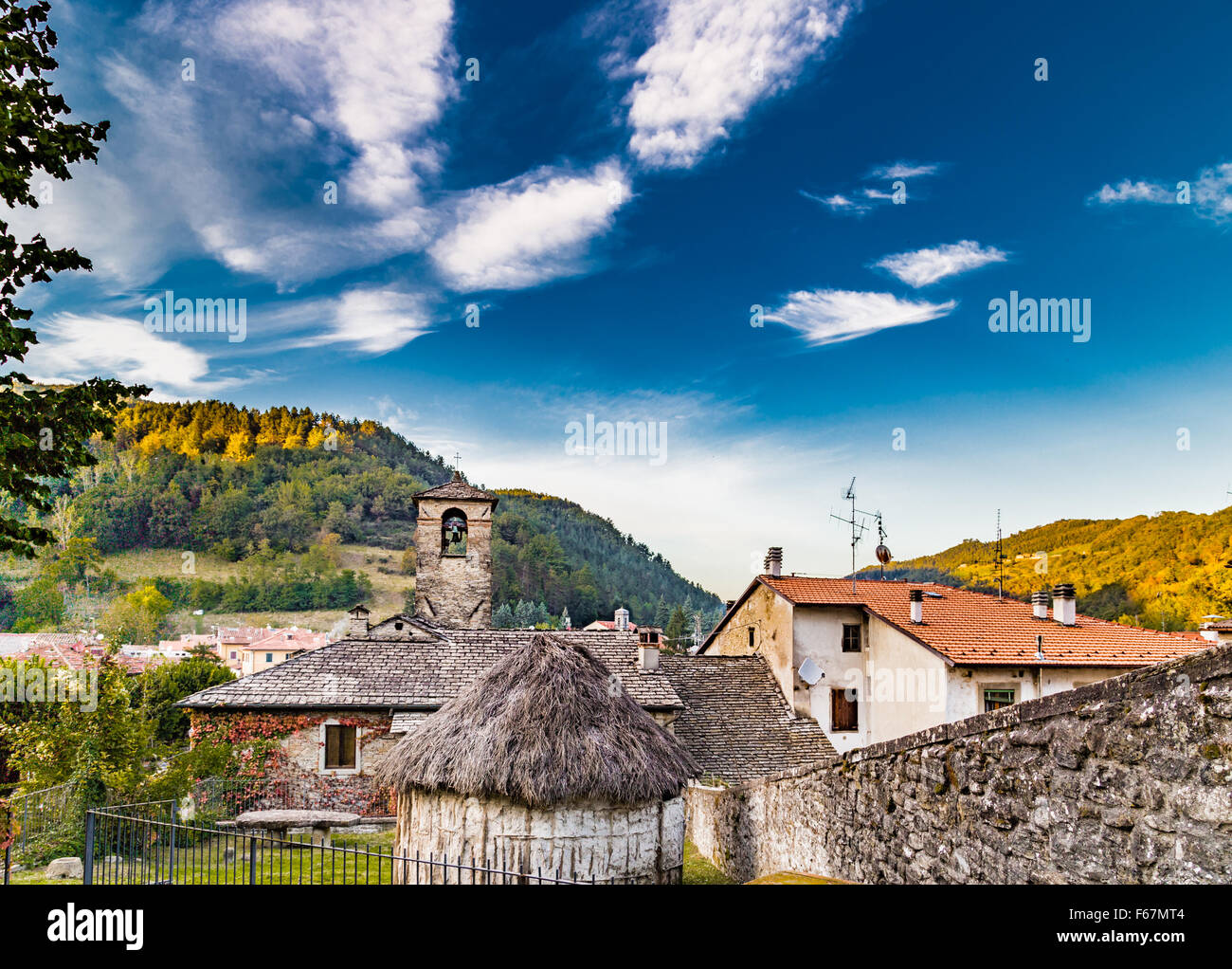 The Palace of the Captains and a straw hut in medieval mountain village in Tuscany characterized by houses with Stock Photo