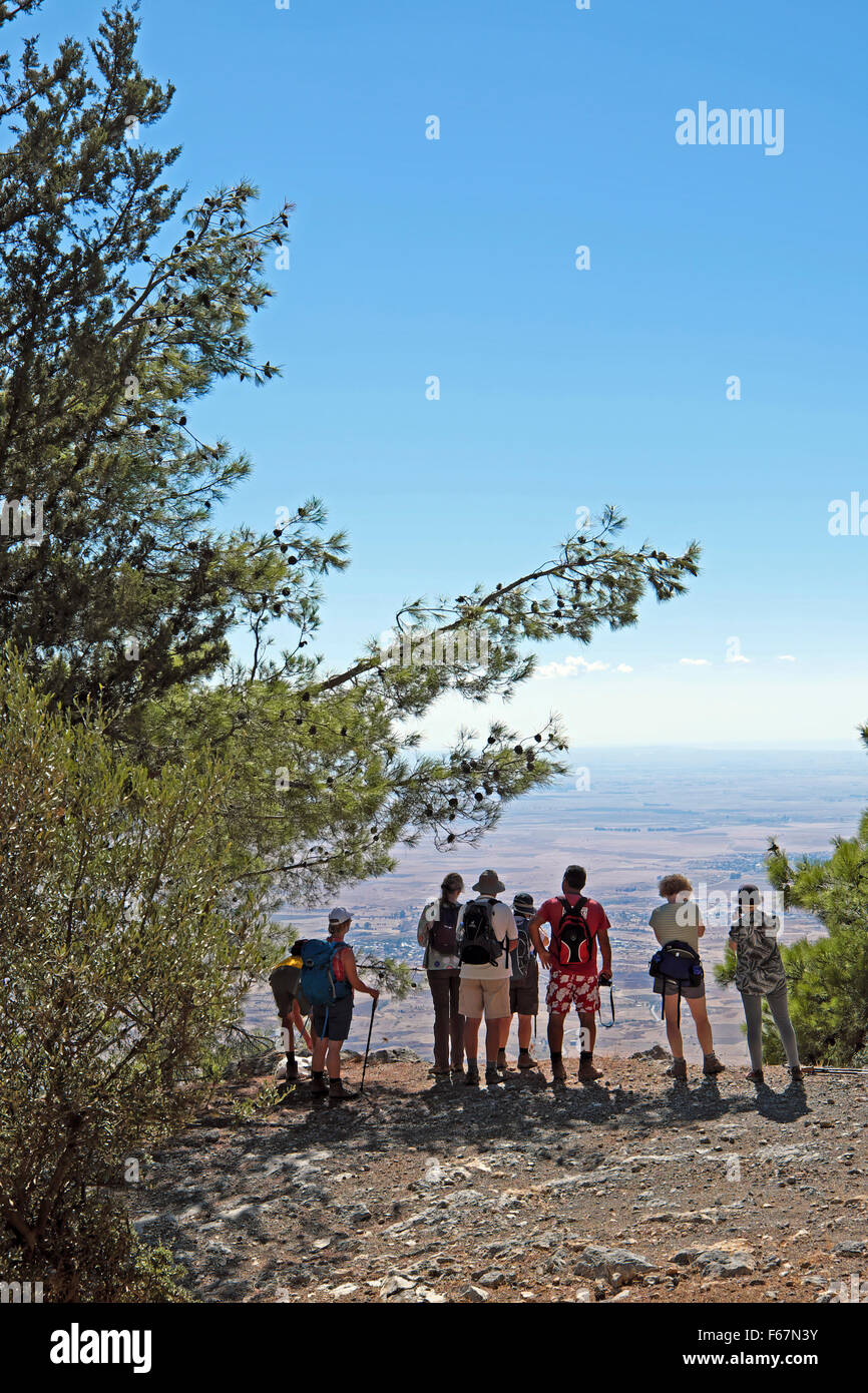 A group of hikers regard the view while on holiday walking in the Besparmak Mountain Range in North Cyprus  KATHY - Stock Image