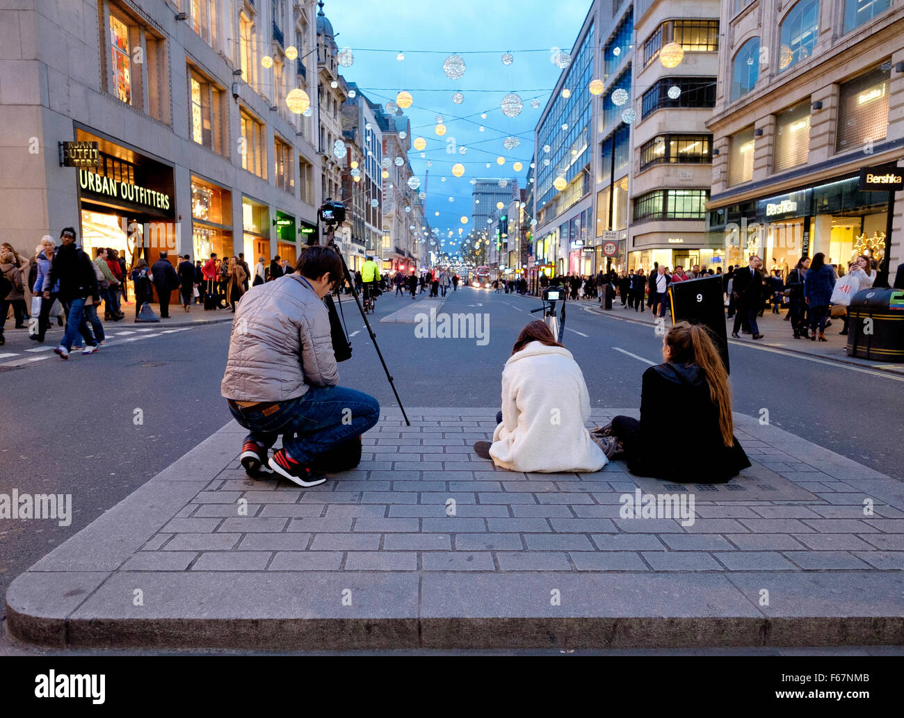 Oxford Street, London, 12 November 2015: Photographers in the centre of Oxford Street using tripods to take photos - Stock Image