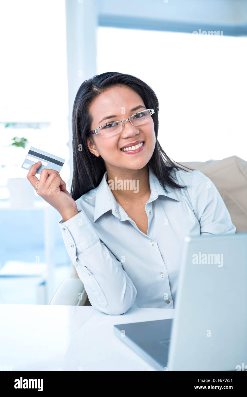 Smiling businesswoman holding credit card Stock Photo