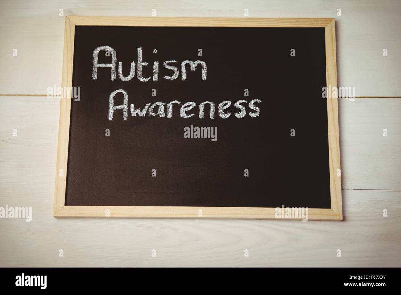Autism awareness drawn on blackboard - Stock Image