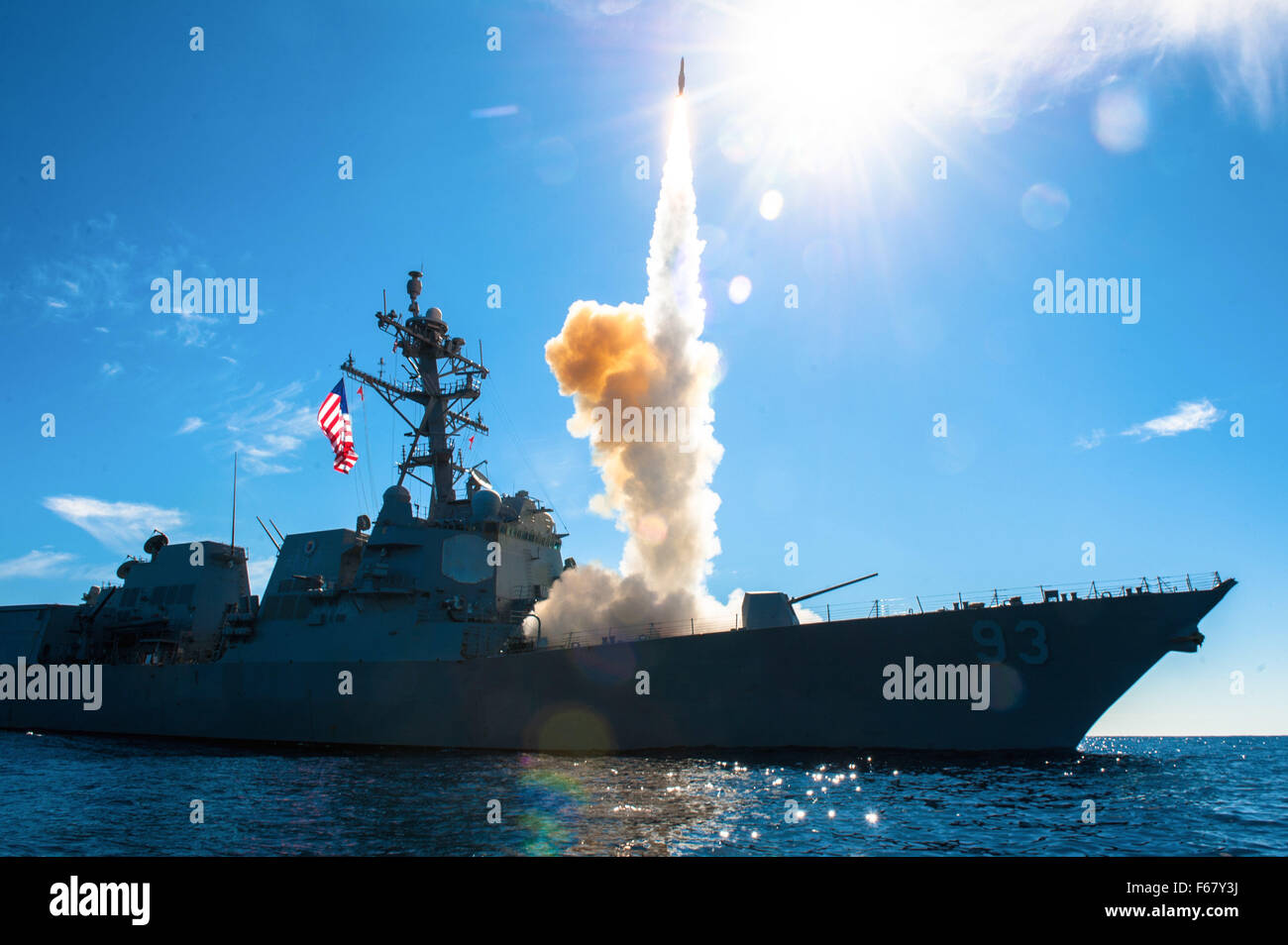 The U.S. Navy Arleigh Burke-class guided-missile destroyer USS Chung-Hoon launches a Standard Missile 2 from the - Stock Image