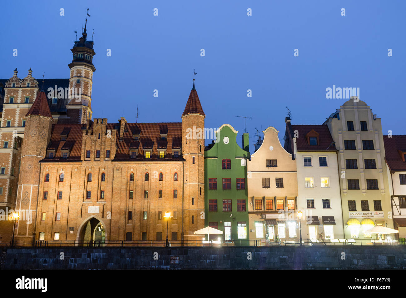 Waterfront tenement houses by night. Gdansk, Poland - Stock Image