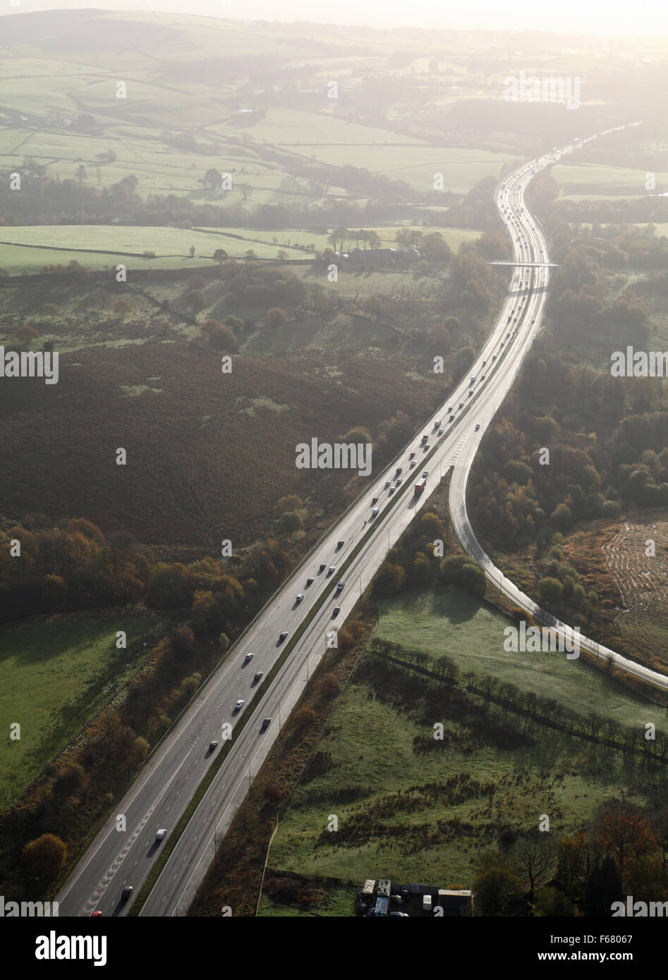 aerial view of a dual carriageway main road into the sun, UK - Stock Image