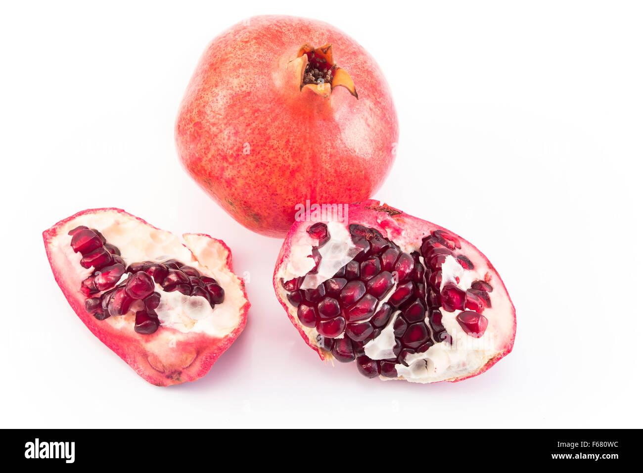 Ripe pomegranate isolated on white. - Stock Image