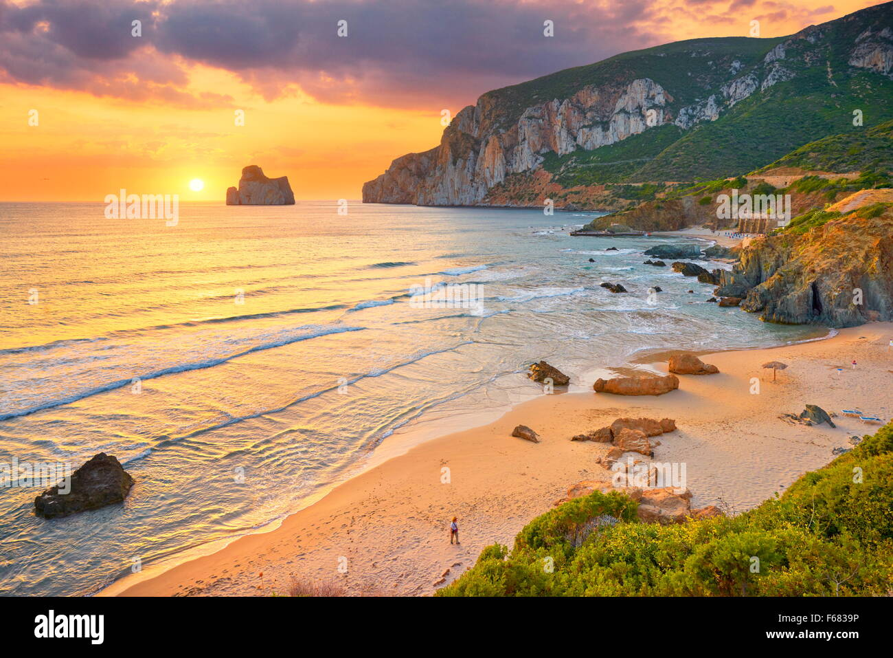 Pan di Zucchero at sunset time, Masua Village Beach, Sardinia Island, Italy - Stock Image