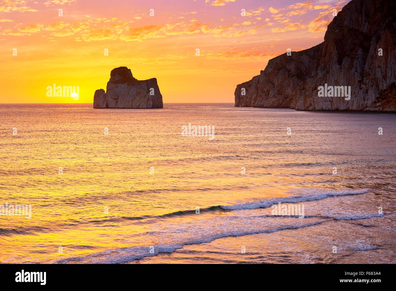 Pan di Zucchero at sunset time, Masua Village, Sardinia Island, Italy - Stock Image