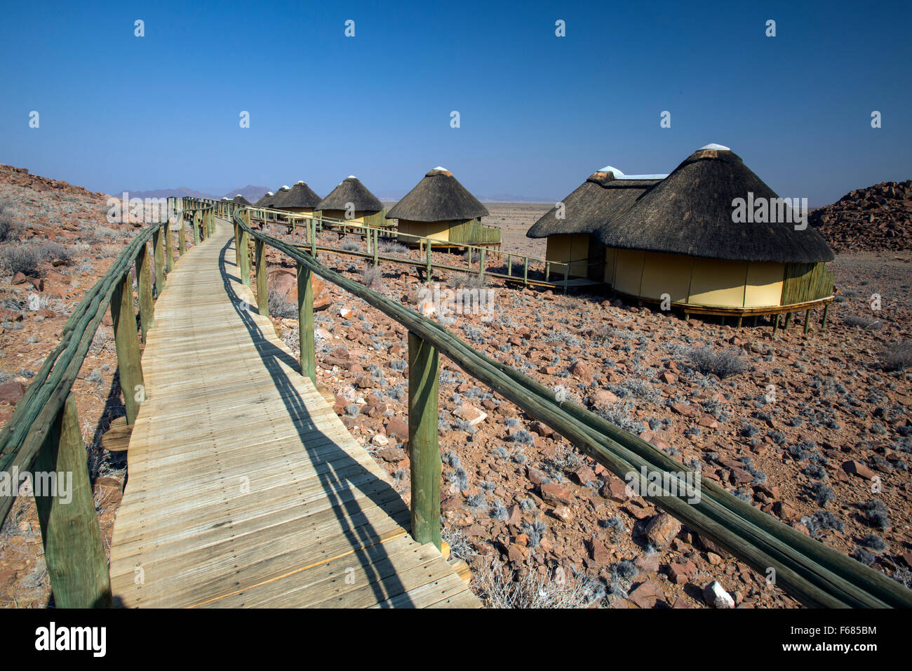 Sossus Dune Lodge thatch huts in Sossusvlei, Namibia, Africa - Stock Image