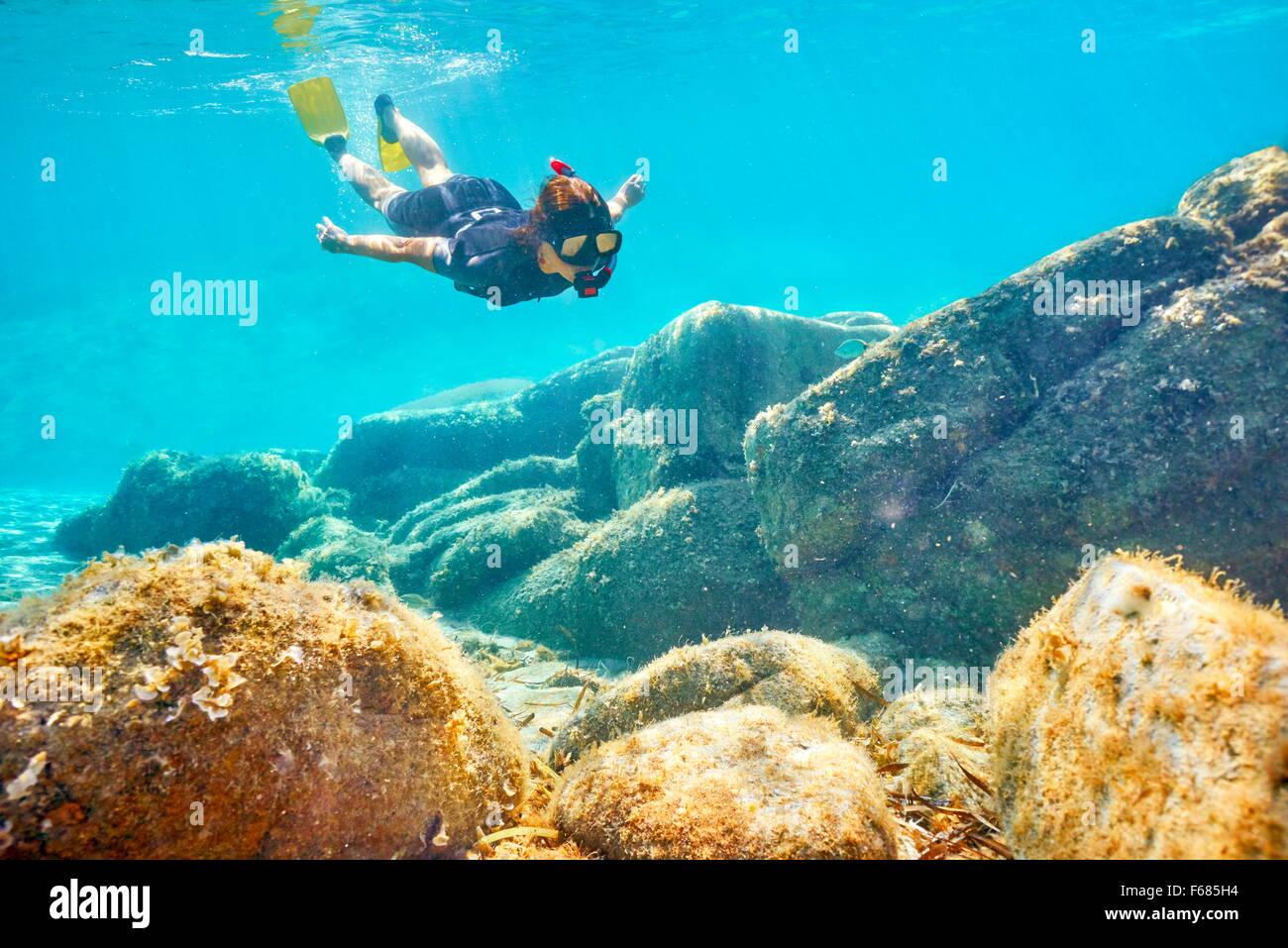 Woman snorkeling underwater, Costa Smeralda, Sardinia Island, Italy - Stock Image