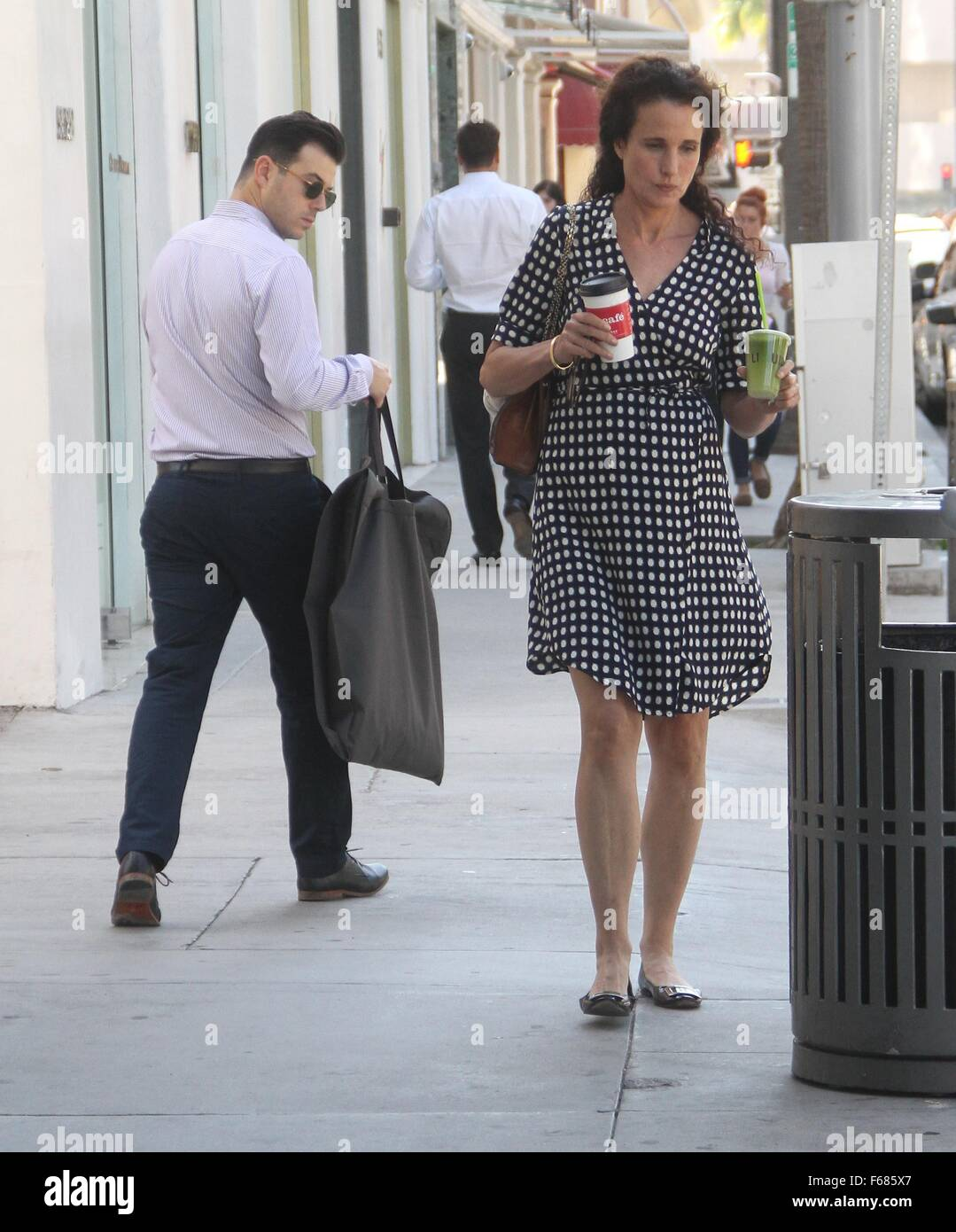 6b788050a0c Andie MacDowell wearing a polka dot dress with flat shoes