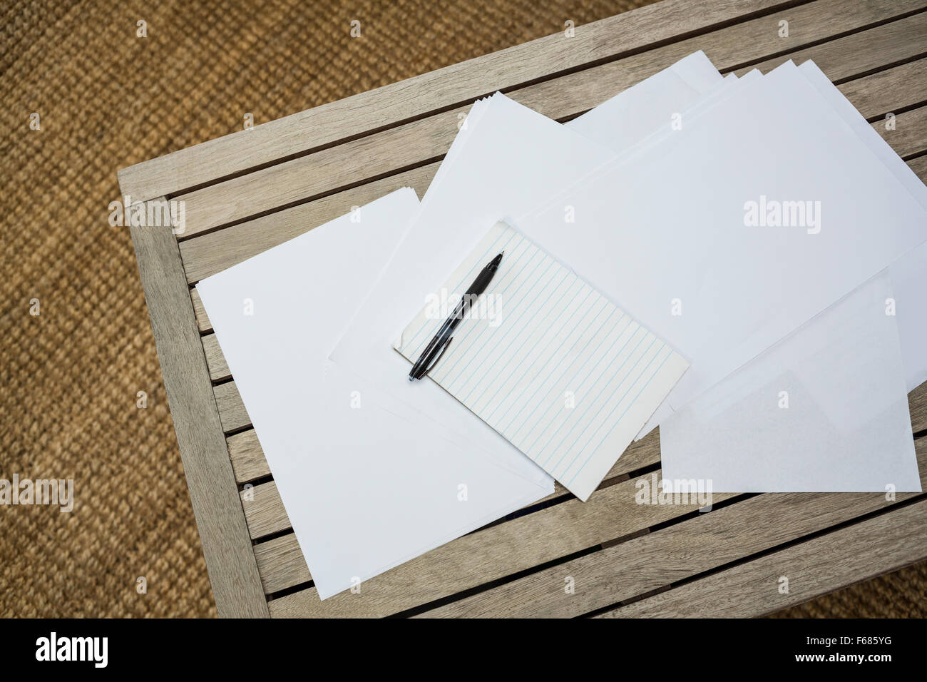 Papers on wooden table - Stock Image