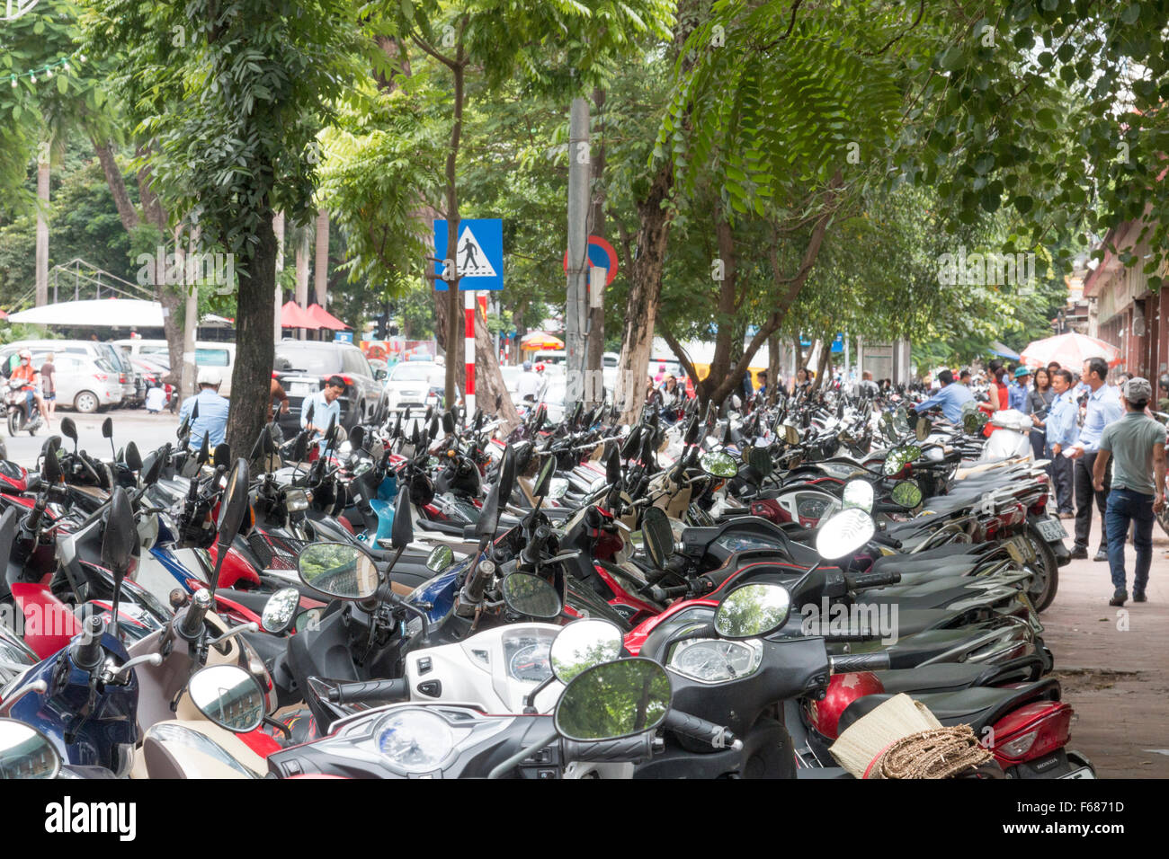 congested parking of motorbikes and scooters in Hanoi city centre,Vietnam - Stock Image