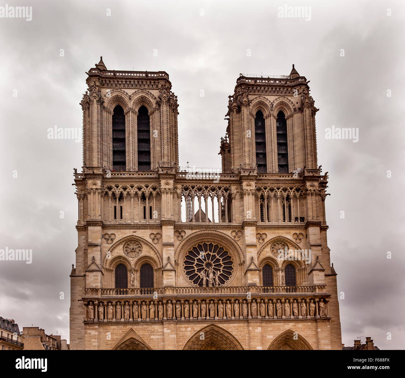 Facade Towers Overcast Skies Notre Dame Cathedral Paris France.  Notre Dame was built between 1163 and 1250 AD. - Stock Image