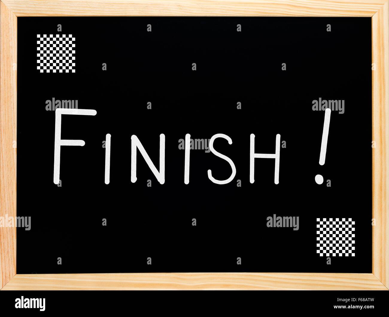 Finish and chess flag written on blackboard or chalkboard - Stock Image