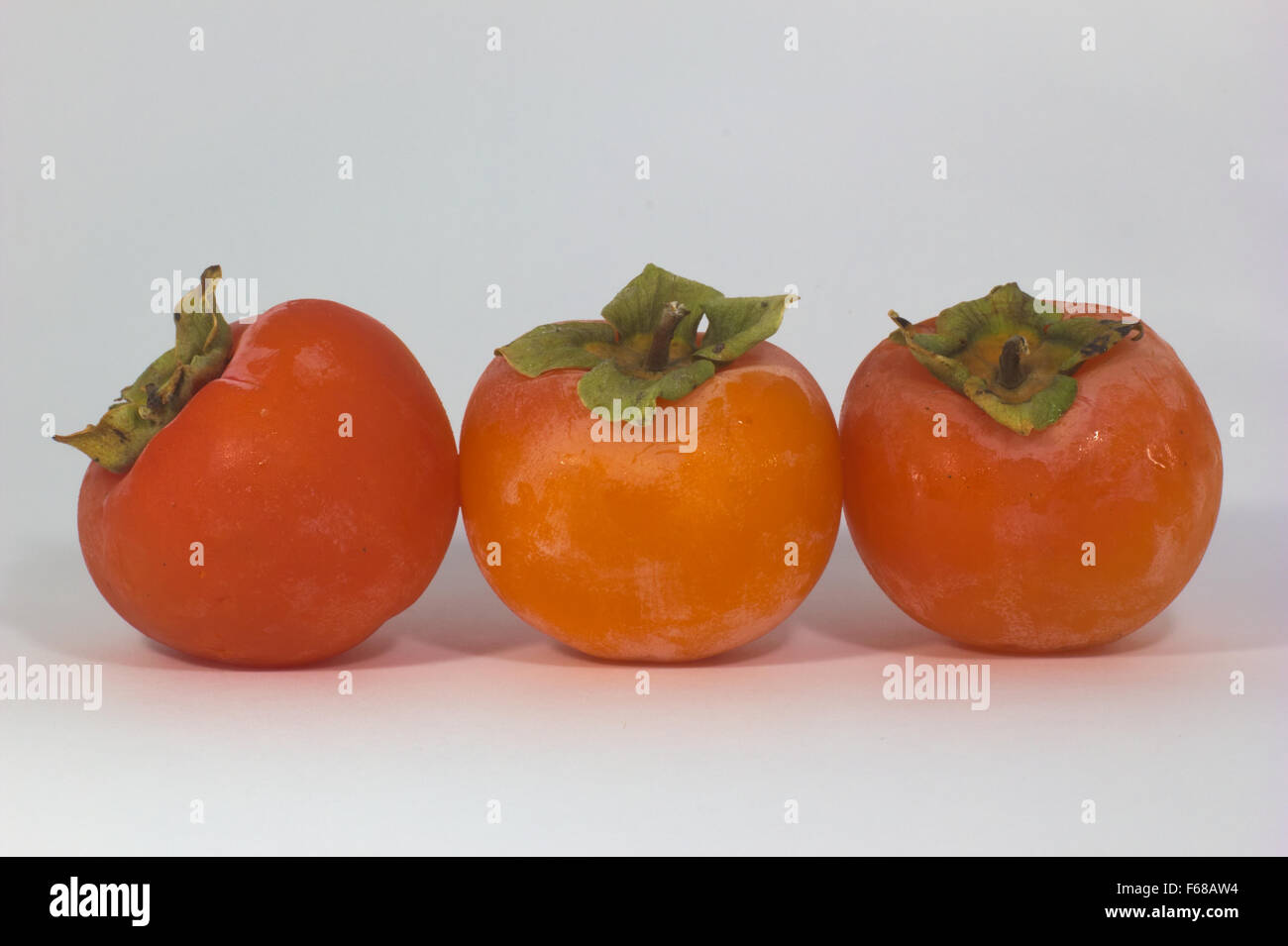 close-up of fabulous persimmon orange and green - Stock Image
