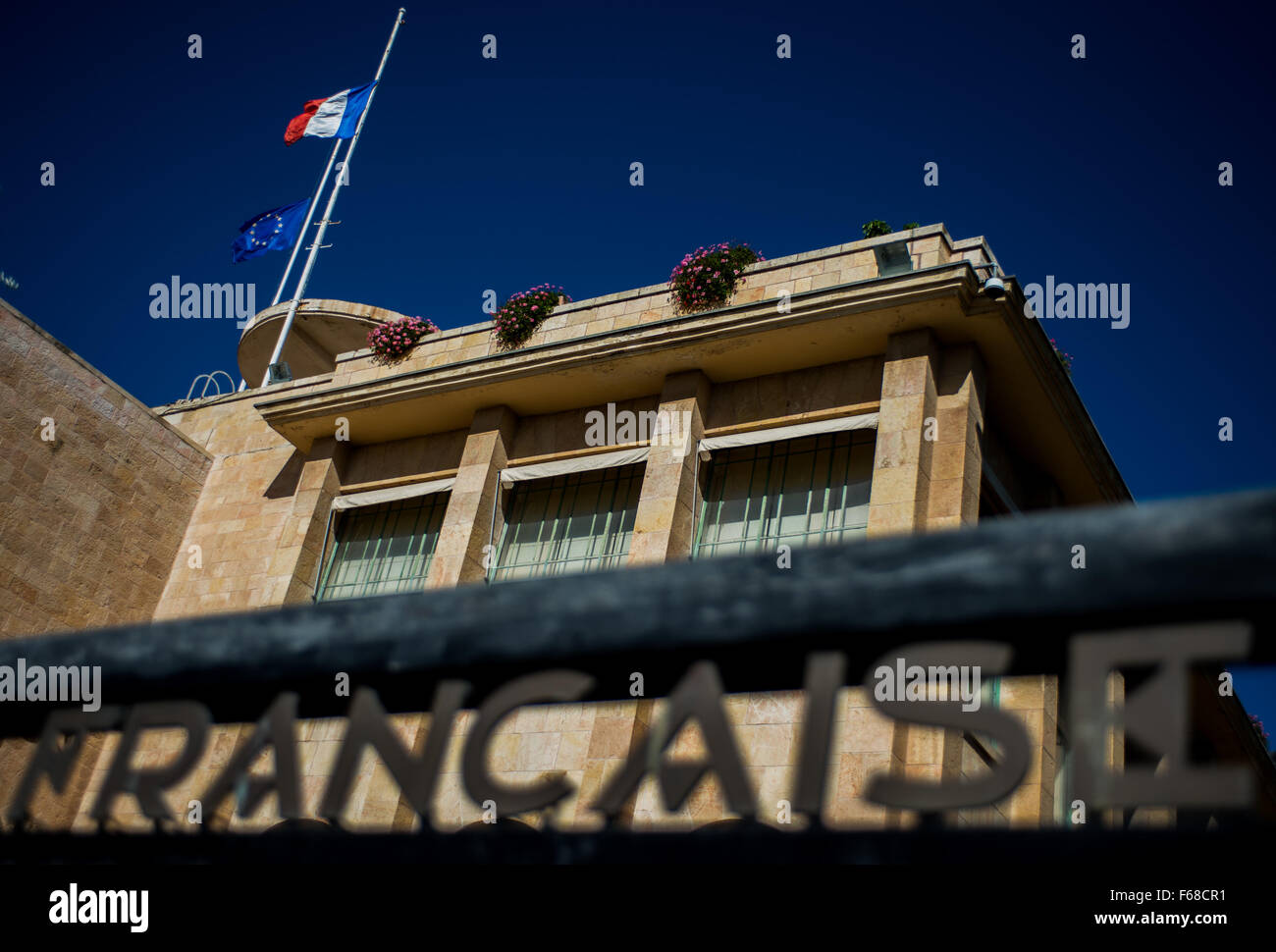 Jerusalem. 14th Nov, 2015. A French national flag and an European Union flag fly at half mast at Consulate General of France in Jerusalem to mourn the victims of a series of attacks in Paris, on Nov. 14, 2015. Credit:  Li Rui/Xinhua/Alamy Live News Stock Photo