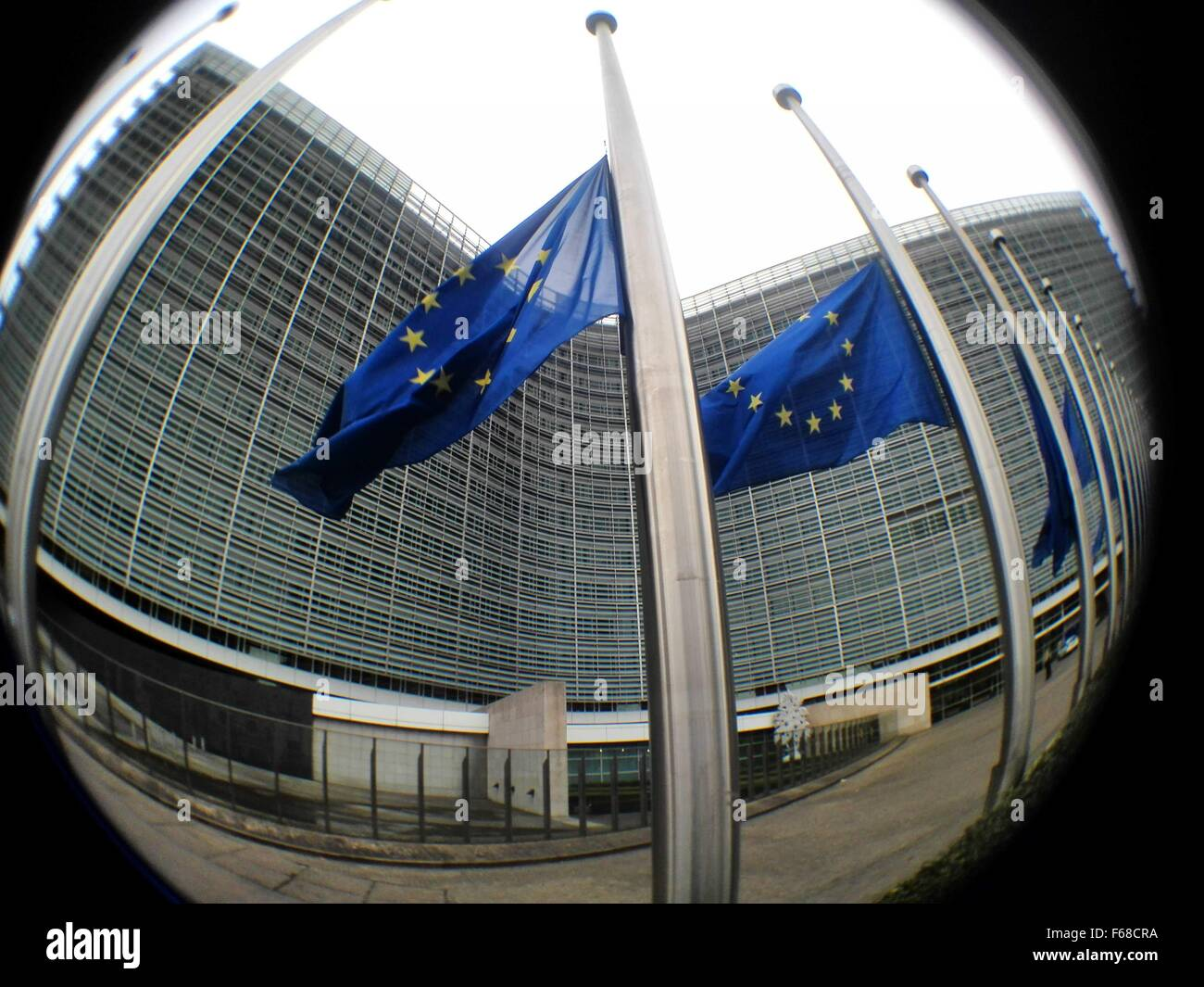 Brussels, Belgium. 14th Nov, 2015. European Union flags fly at half mast to mourn the victims of a series of attacks - Stock Image