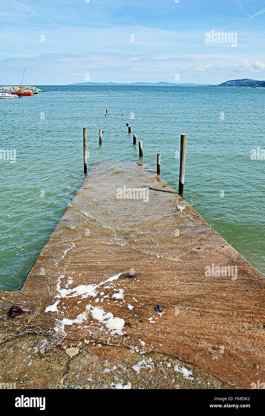 The harbour at Rhos-on-Sea, showing the main jetty. - Stock Image