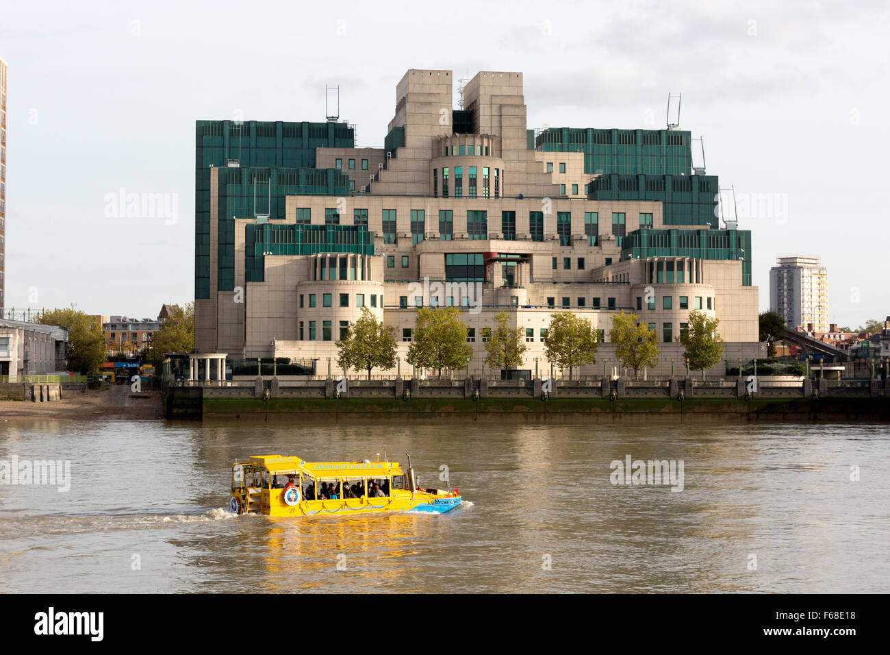 London Duck Tours amphibious vehicle on the river Thames passing the MI6 headquarters, Vauxhall, London - Stock Image