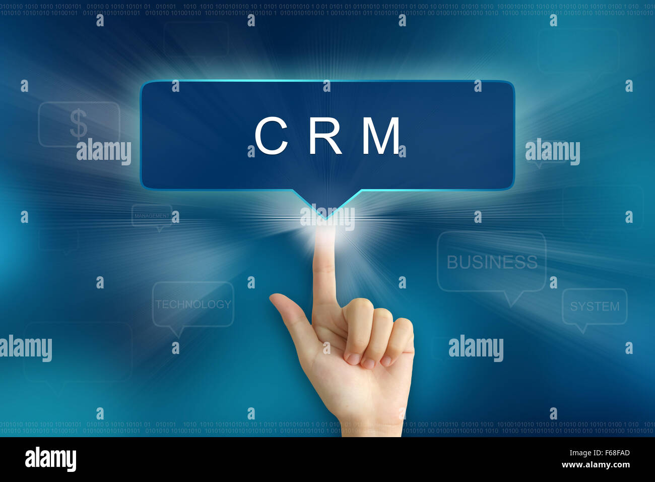 hand pushing on CRM or Customer relationship management balloon text button - Stock Image