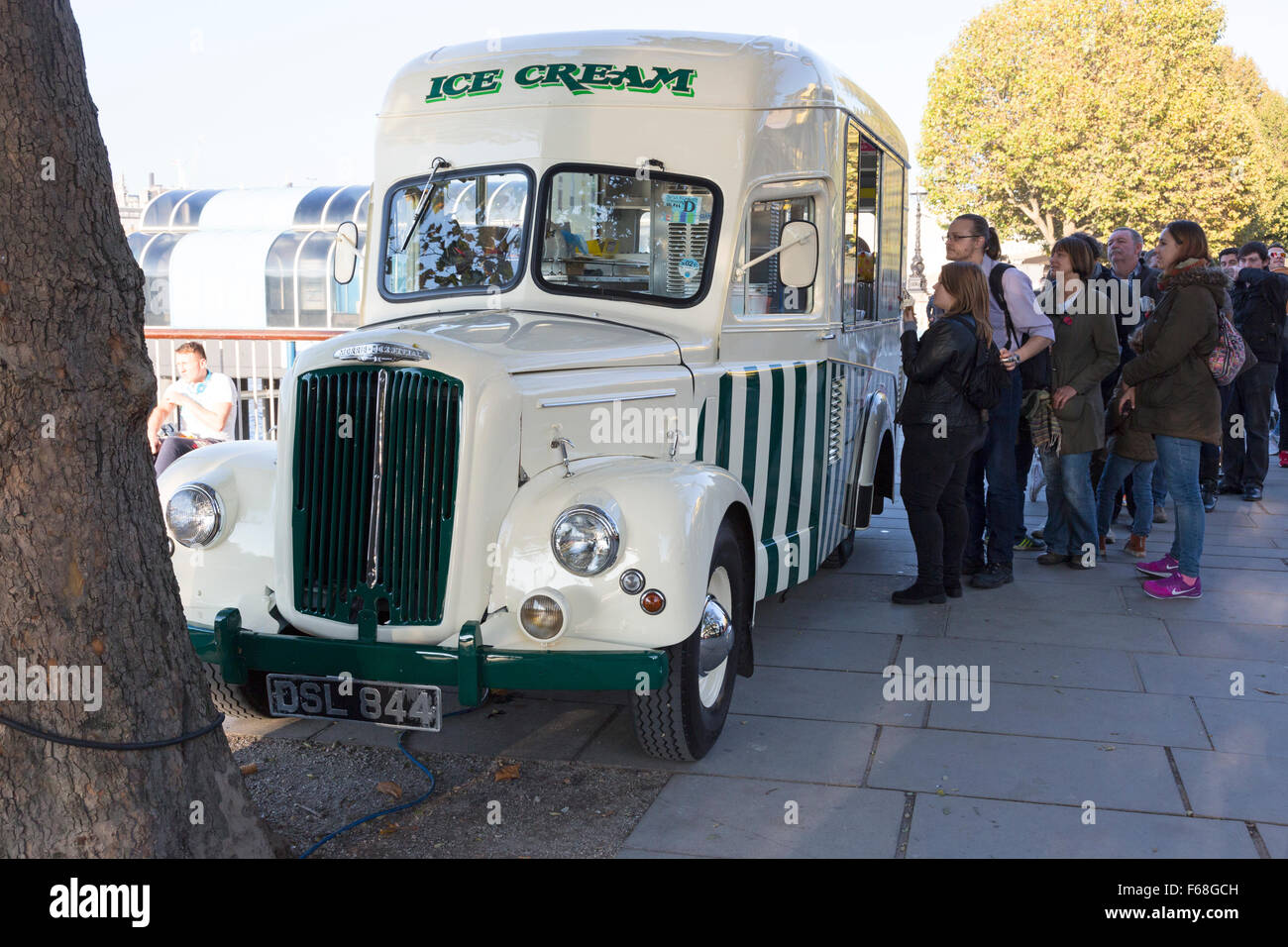 People queueing for ice cream from a 1950s Morris Commercial van, South Bank, London Stock Photo