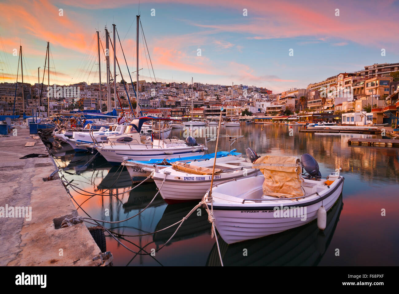 Boats mooring at a pier in Mikrolimano marina in Athens, Greece - Stock Image