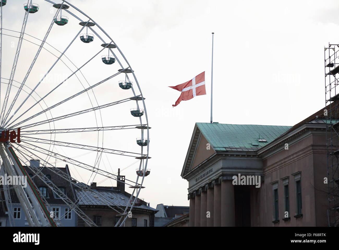 Copenhagen, Denmark. 14th November, 2015. The Danish flag is flown at half mast on public buildings and around the Stock Photo
