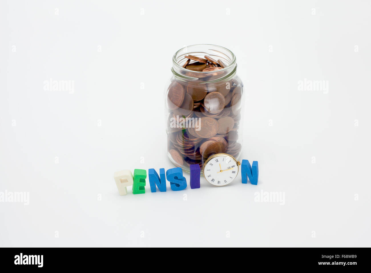 Pension coins in a glass jar with text and clock - Stock Image