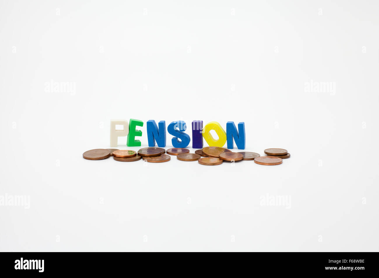 word pension with coins on white background - Stock Image