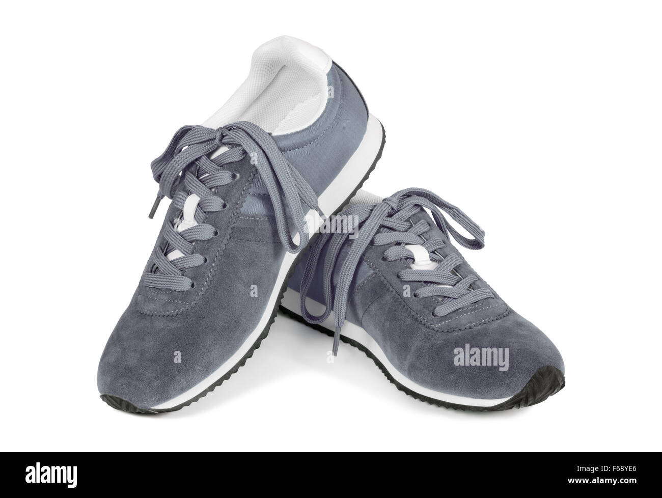 Grey running shoes isolated on white background. Casual style sneakers. - Stock Image