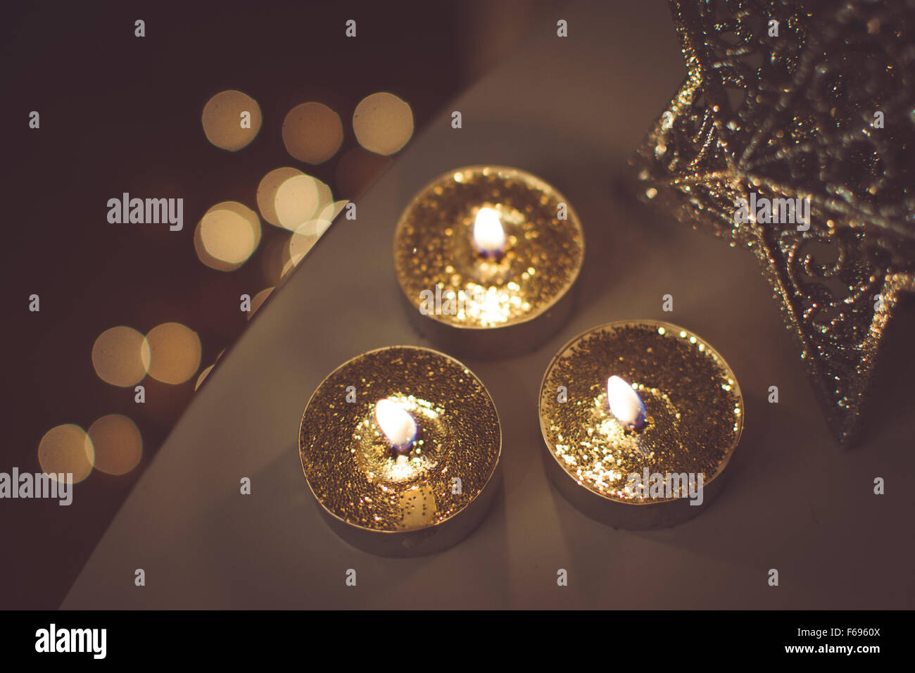 Christmas golden candles - Stock Image
