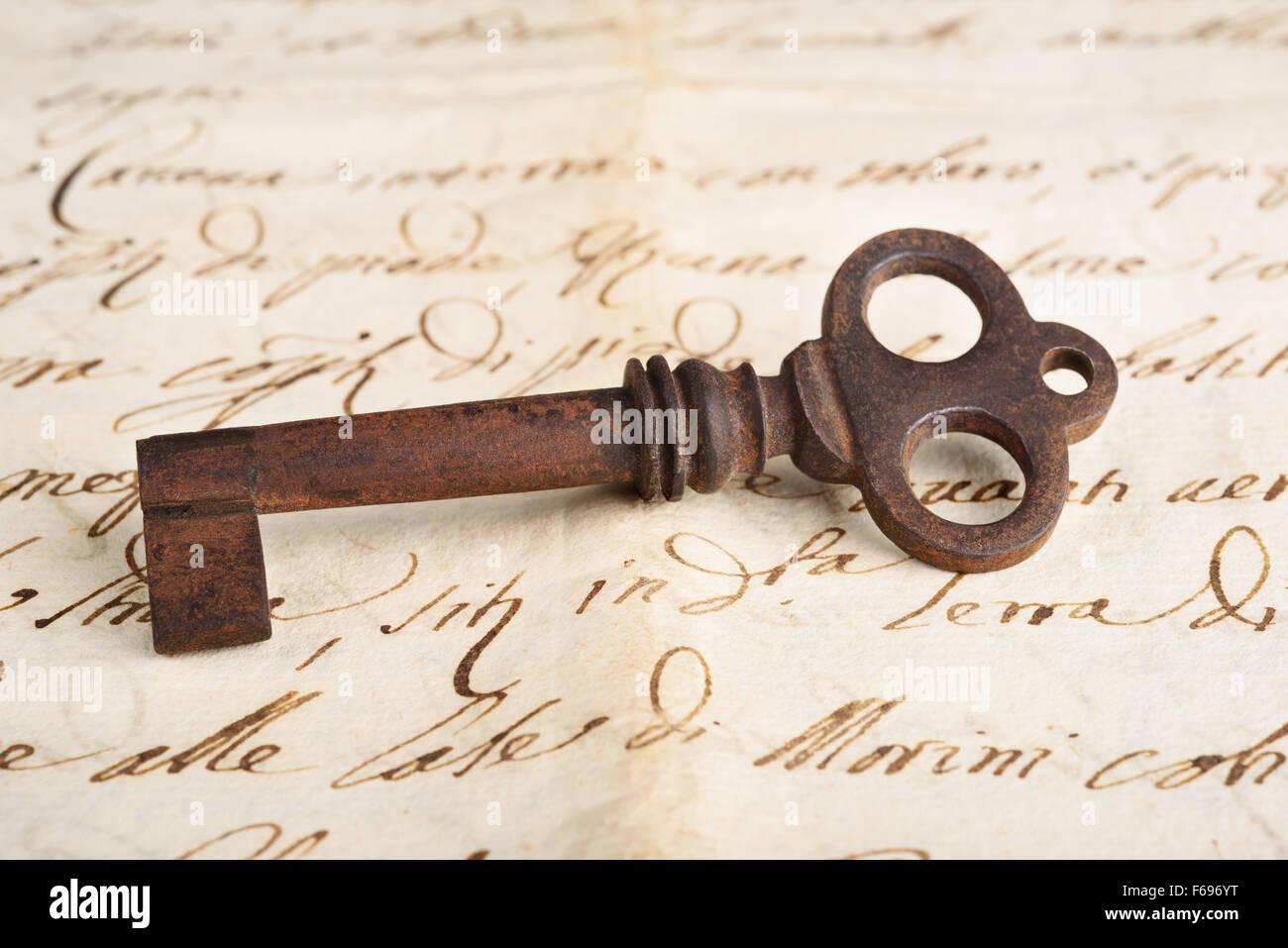 Old key on letter background - Stock Image