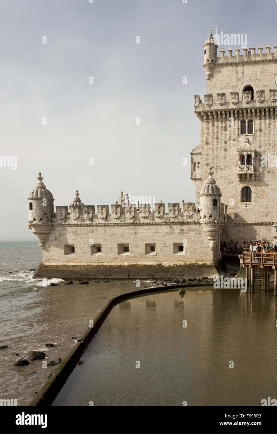 LISBON, PORTUGAL - OCTOBER 24 2014: external View of Belem Tower of Lisbon, Portugal, with people waiting to enter - Stock Image