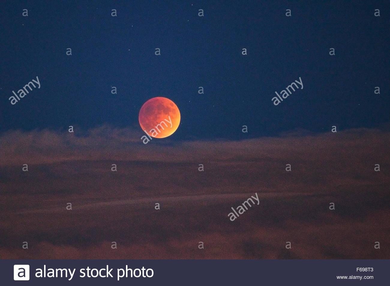 Super Blood Moon Rising Above Clouds, Tilden Regional Park, Berkeley, California - Stock Image