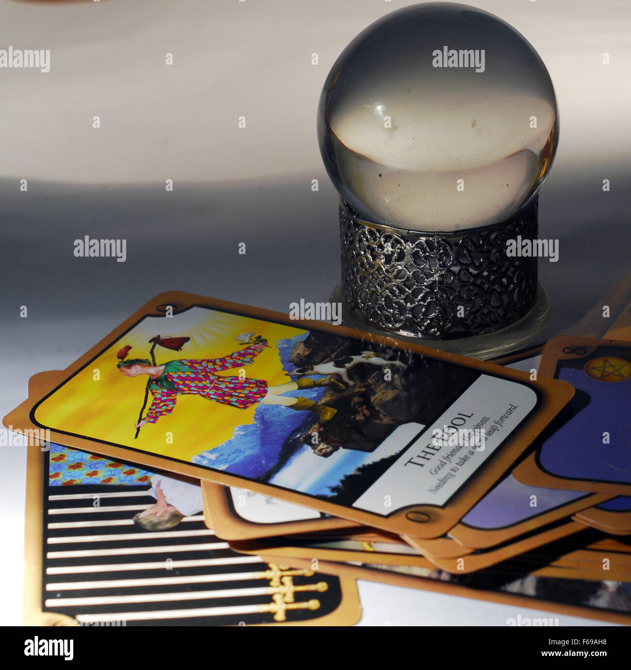crystal ball,future,fortune teller ,gypsy,tarot,reading,fool,card, - Stock Image
