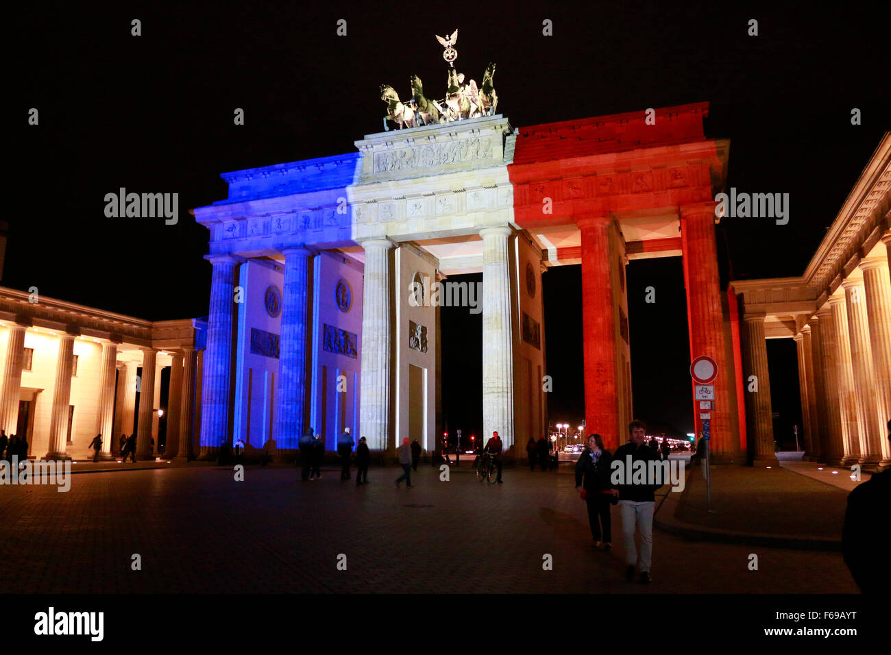 NOVEMBER 14, 2015 - BERLIN: the Brandenburg Gate in the colors of France -  mourning at the French Embassy in Berlin - Stock Image